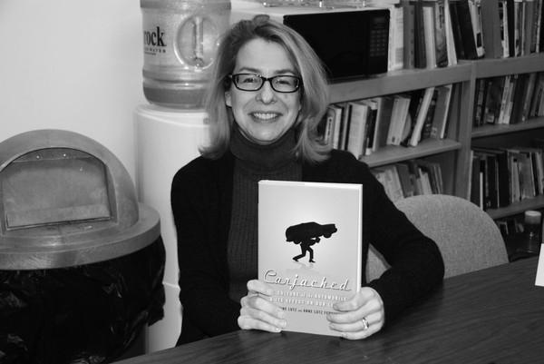 English teacher Anne Fernandez, pictured above with her book