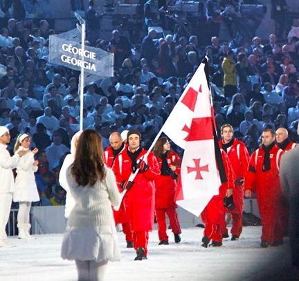 Nodar Kumaritashvili (above holding flag) was an admirable member of the Georgian Olympic team   Photo by s.yume