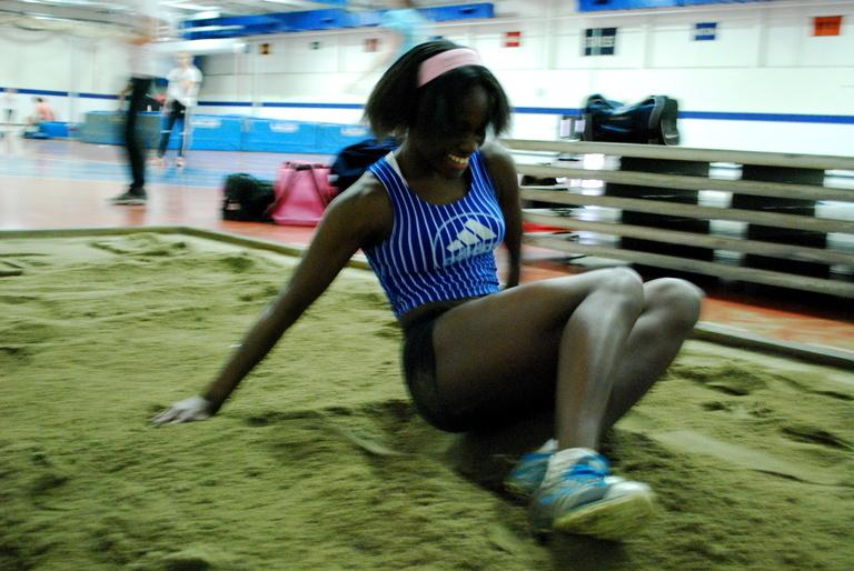 Joseyn Henry completes the long jump. | Photo by Madeline Hardy '11