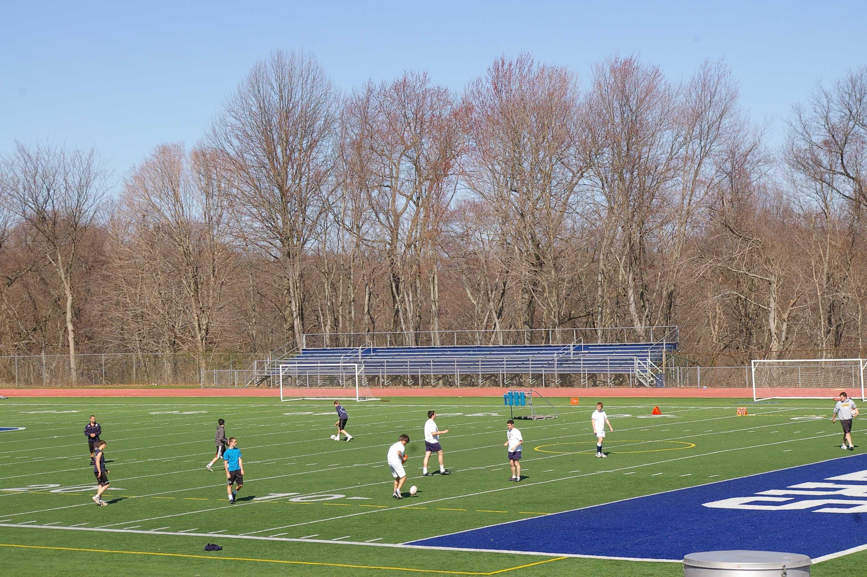 The rugby team practices for their upcoming games. | Photo by Alicia Lourekas '12
