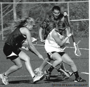 TRAP: Ali Crofts '12 puts herself in a position to make a play on the ball