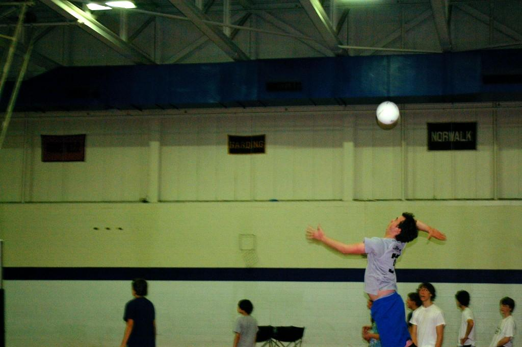 Andrew Glenn '10 serves the ball during practice. The team is hoping to have a successful season like last year's and become FCIAC champs once again. | Photo by Byran Schiavone '13