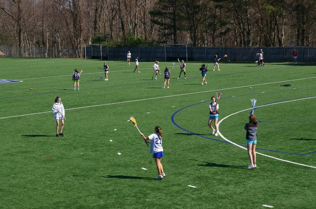 With so many girls interested in playing lacrosse this year, 77 to be exact, Coach Schager was forced to make cuts for the first time ever. | Photo by Carlie Schwaeber 12