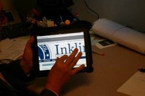 CAUGHT: Science 6-12 Coordinator AJ Sheetz checks out the Inklings website on the iPad. | Photo by Sammy Warshaw '12