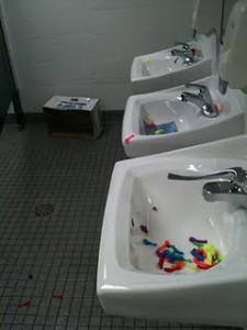 The remains of the senior water balloon fight lie in the sink.