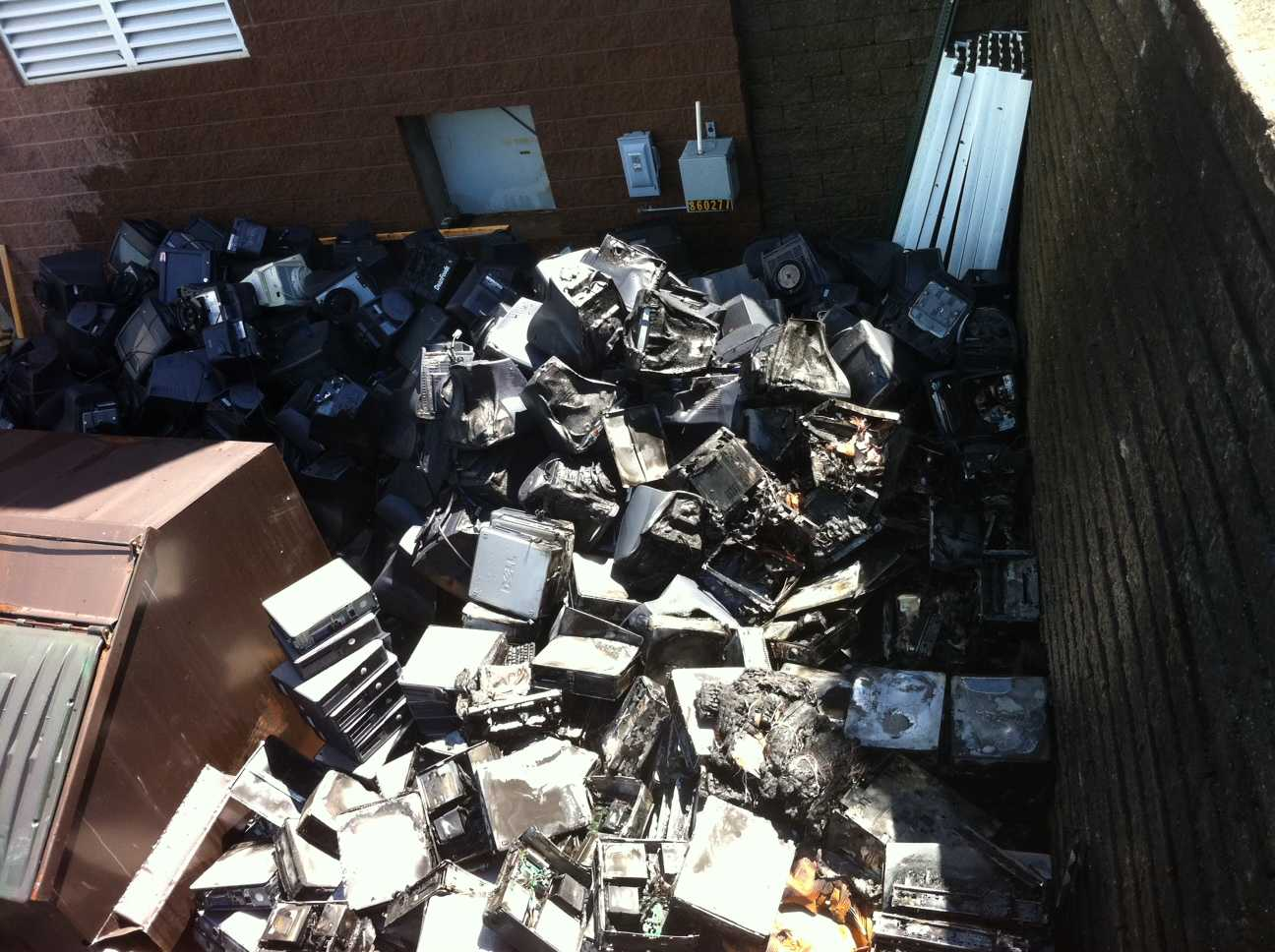 The heat of the fire partially melted the pile of abandoned computers outside of Bedford Middle School | Photo Mark Schwabacher '13