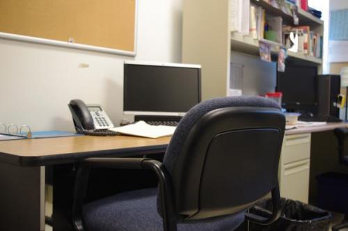 Former Staples English teacher Werner Liepolt's desk now sits empty next to that of English teacher Holly Sulzycki's.