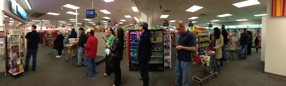 Shoppers wait for prescriptions on Sunday evening.