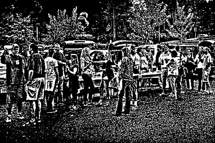 Pre-Game Celebrations: A group of parents tailgating before a recent Staples football game.