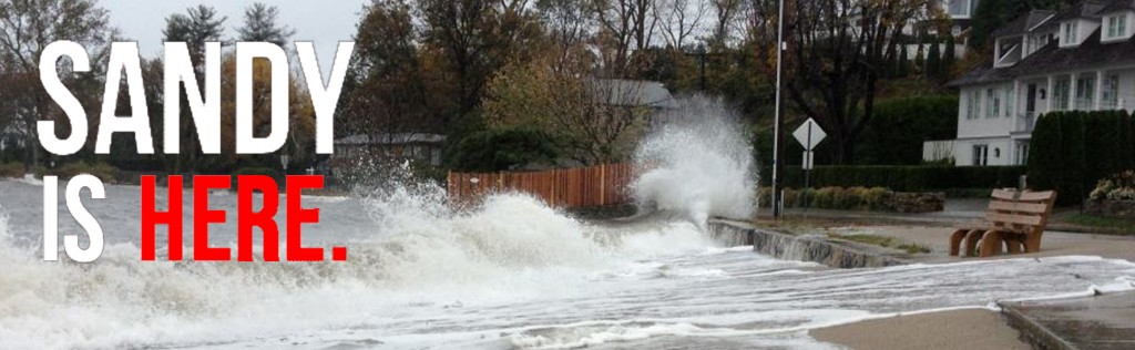 Sandy marks her arrival as waves crash along Mill Beach.