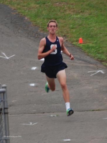 Henry Wynne '13 running cross country.