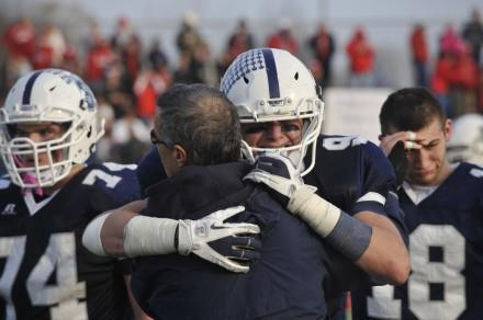 Senior Jared Levi is comforted by a coach.
