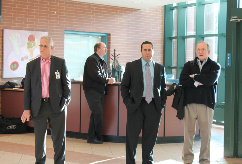Some of the Staples administration looks on at the foyer on the day of the shooting.