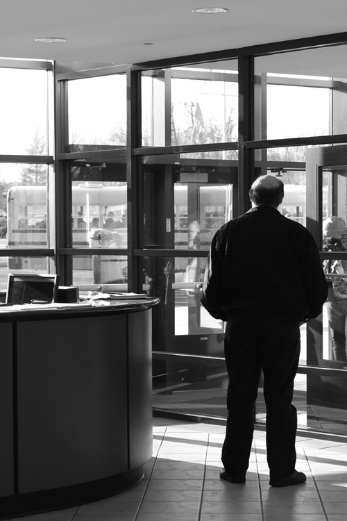 David Dubois, a security guard at the front desk, watches as visitors enter. Security staff and specific policies help keep the school safe.