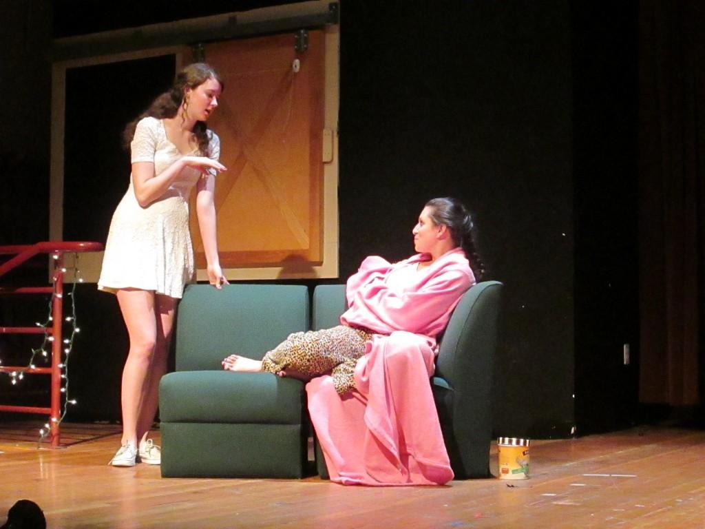 Julia Greene '15 gives Rachel Samuels '13 relationship advice onstage in
