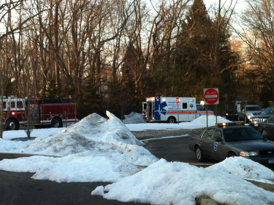 An ambulance and fire engine arrived in response to an accident in the parking lot. The one-car accident reportedly involved English teacher Jesse Bauks.
