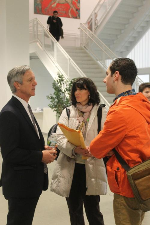Natalie Clay (center), a Staples French teacher, and August Laska '13 (right) talk to Staples parent Tony Banbury from the U.N. (left).