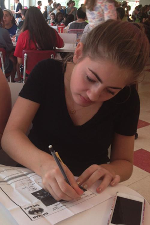 After a morning of rides, Brittany Silver '14 pauses to complete her calculations.