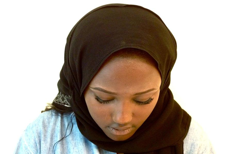 Amina in her traditional hijab, which she wears when praying.