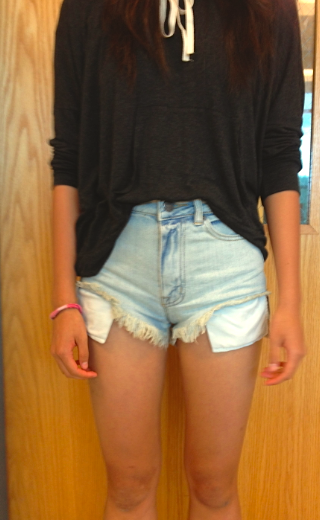 Annie Gao models the previous style as well: simple denim high waisted shorts and a comfy, loose shirt.
