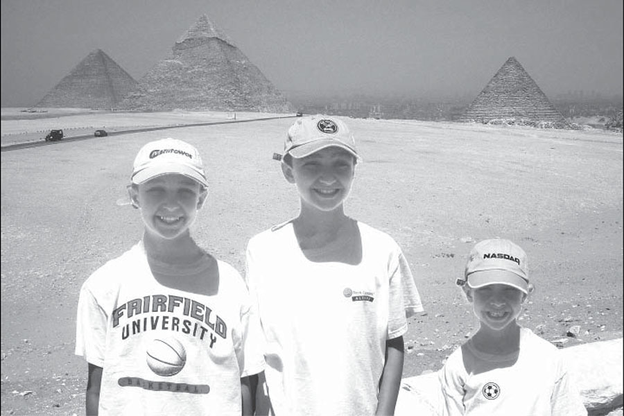 Too dangerous to travel: Massoud and his younger brothers pose near the pyramids during their last family trip to Egypt in 2009. The violence has prevented families like Massoud's from returning.