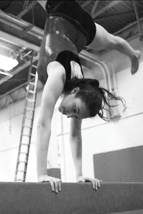 Balancing Act: Deanna Baris '14 practices on the balance beam at Arena Gymnastics.