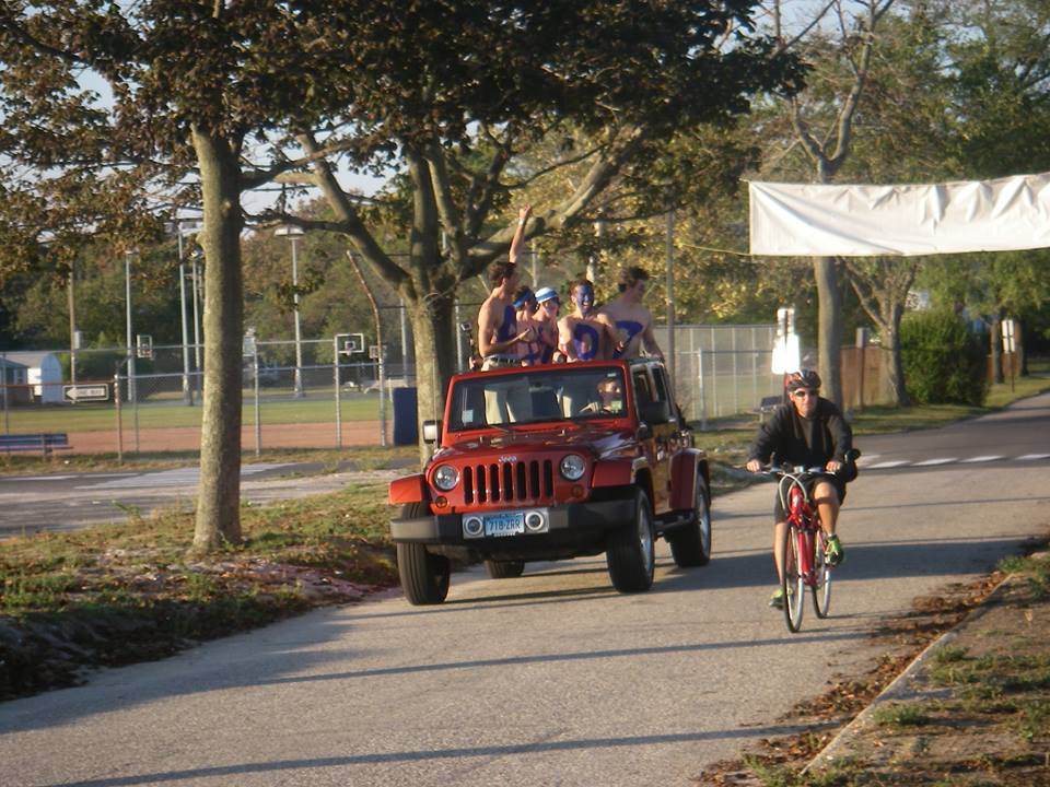 A+group+of+senior+boys+ride+through+the+beach+in+entrance+to+join+their+fellow+seniors+in+their+last+motorcade+and+homecoming+together.%0D%0A