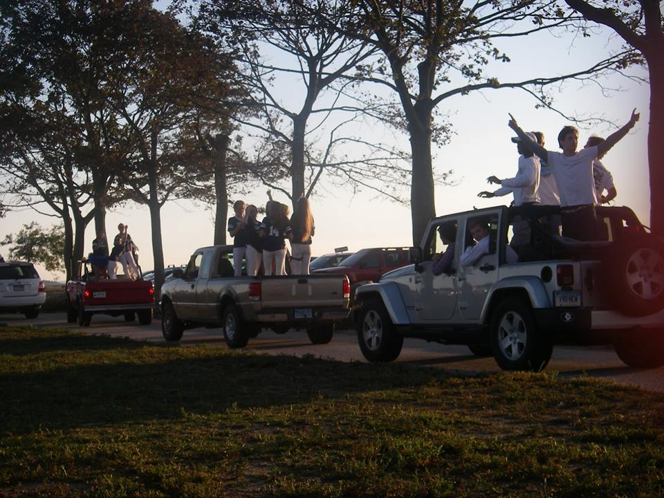 Seniors party on the backs of their cars and get pumped up for the homecoming game.