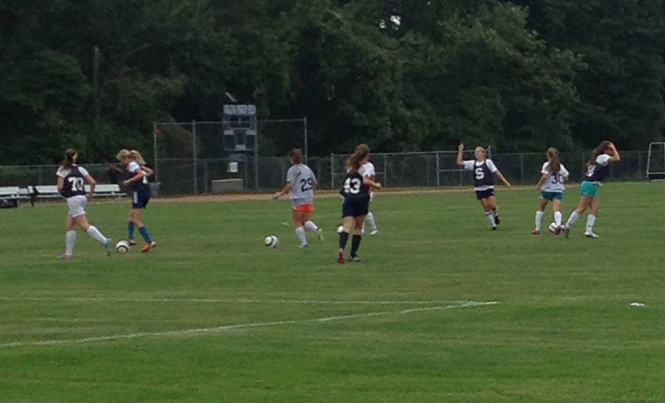 Players on girls varsity soccer practice for their next game.