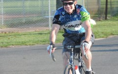 After passing his family, this man is all smiles as he makes his way to the end of the bike route.