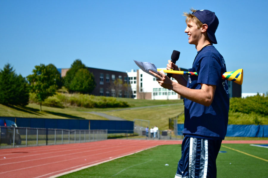 Peter Elkind reads the names for students receiving the awards for best Spirit Week outfits.