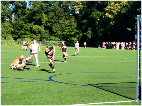 Staples defense played their hardest against Warde's strong offensive line. Here goalie Jodie Baris '15 took a tumble in attempts of stopping a goal. Talk about commitment.