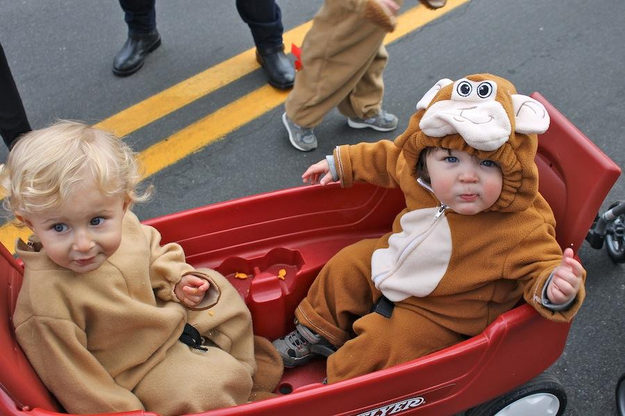 Ethan Hall and Jordan Rubin monkey around as they are towed through main street in a bright red wagon.