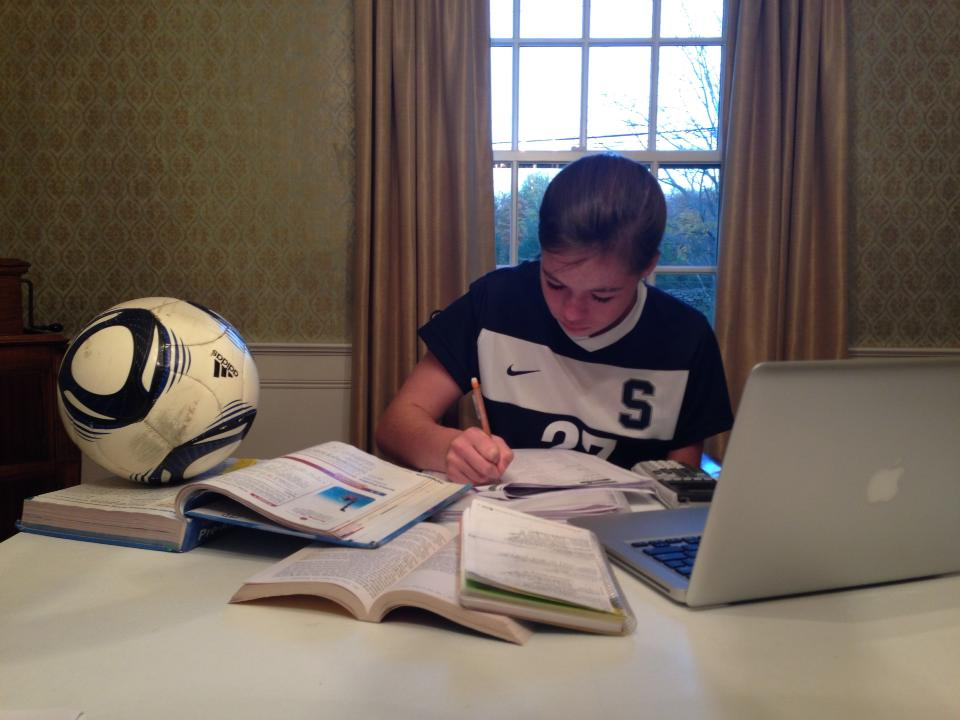 Charlotte Rossi '17 has to work efficiently on her homework after a long day of classes and soccer practice.