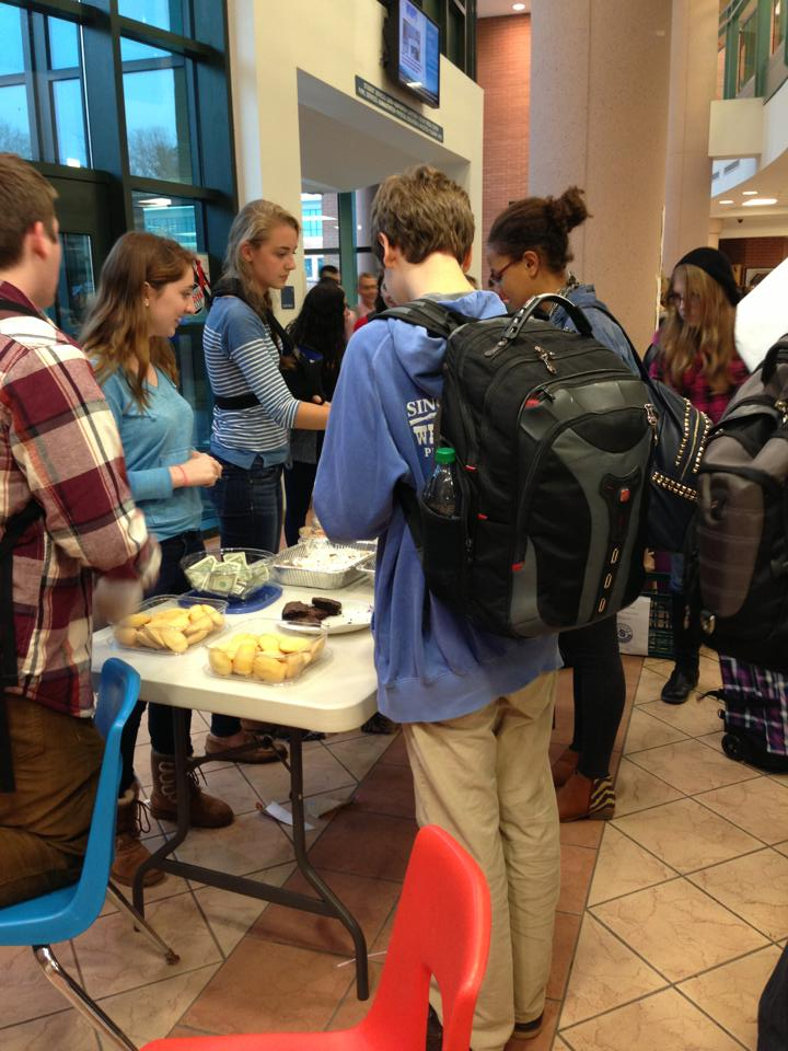 Staples students flock towards the bake sale table when the bell rings at 2:15