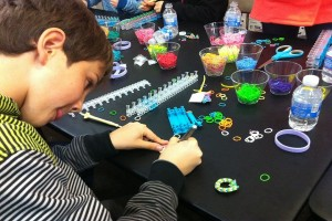 After children made a bracelet, they filled out a card with their name to attach and send with the bracelet. This photo features fourth grader William Burger, who came all the way from New Canaan to make bracelets for the event, filling out a card.