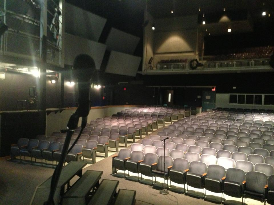 During the hiatus, the auditorium stage remains empty of actors rehearsing