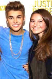 Staff writer Jane Levy poses with Bieber himself.