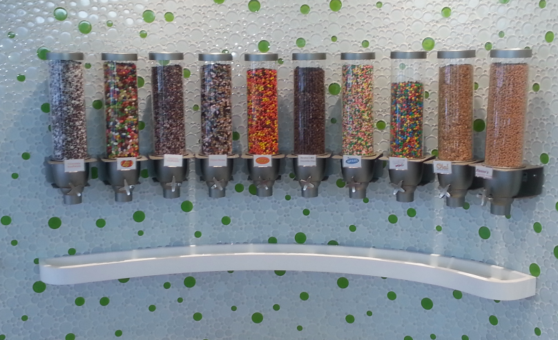Ten of the 60+ toppings that Peachwave has to offer, featuring Reese's Pieces and M&M's.