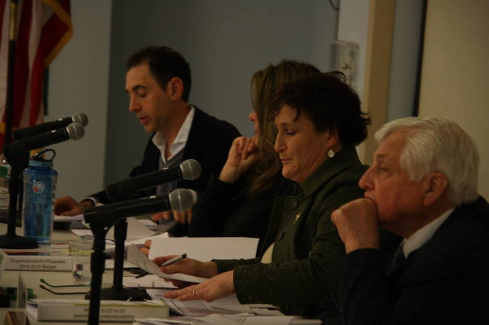 Superintendent Elliot Landon, far right, sits with the Board of Education during Monday night's meeting which determined the school budget.