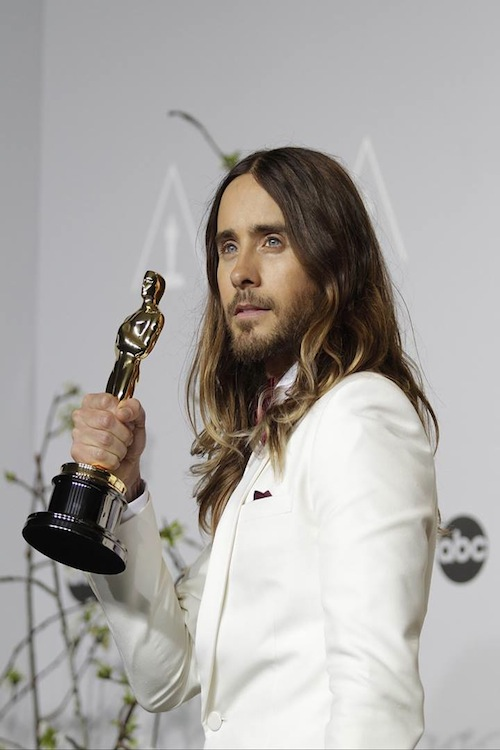 "Jared Leto, who won Best Supporting Actor for his performance in ""Dallas Buyers Club,"" poses with his statue after the Oscars."