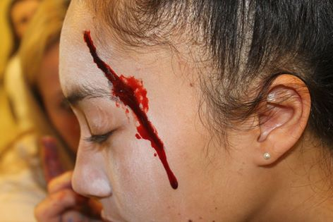 Senior, Terena Koteka-Wiki, a victim, has 'blood' dripping down her face after her 'death.'