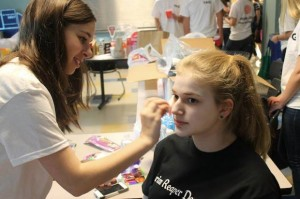 Isabel Perry '15, a member of TAG, puts makeup on victim Carly Singer '14.