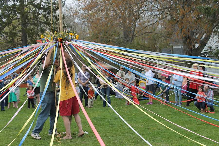 Aitkenhead+and+Bill+Fisher%2C+who+leads+the+maypole+dance%2C+raise+the+maypole+up+the+tree.