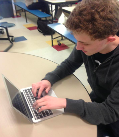 George Menz '16 is hard at work on his National History Day Project.