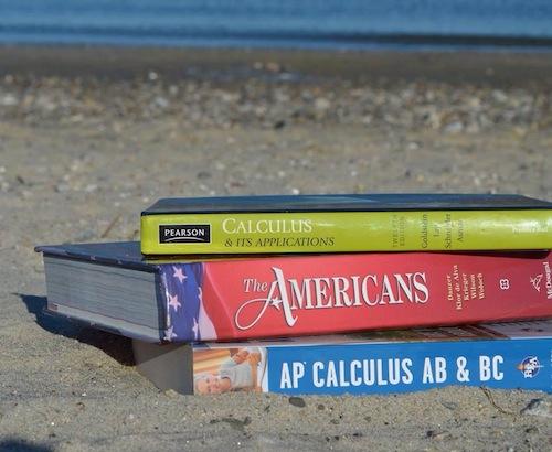 Textbooks trump tan lines