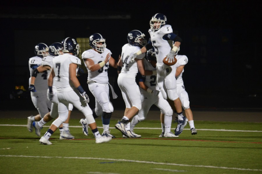 Nick Esposito '15 (#5), celebrates his fumble-recovery-touchdown, accomplishing a defensive goal of the Wreckers
