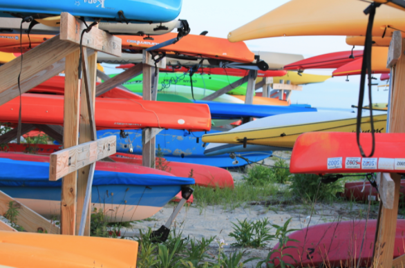 """Yaks on yaks. What would summer be without a dip in the water, paddling around the Long Island Sound with some friends and family?  Ben Hamer '16 spends his summer days working at Longshore Sailing School. """"I get to sail and kayak everyday under the sun, there's nothing better to do during summer time,"""" Hamer said."""