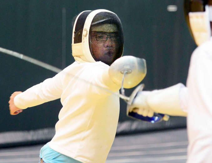 Lunge and beat with the Staples Fencing Club