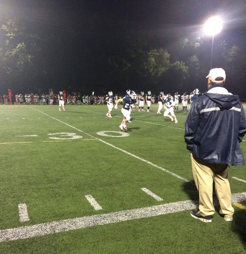 The Wrecker's offense runs the ball around the 30 yard line.